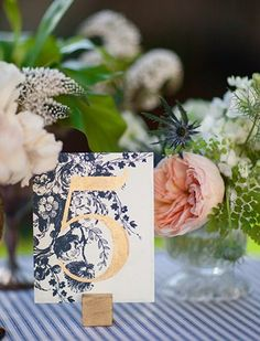 navy floral with gold table number  @myweddingdotcom