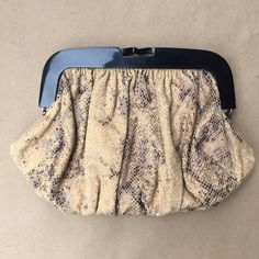 Junior Drake clutch Snake print leather clutch, lined with a pocket inside. Comes with a dust bag. Junior Drake Bags Clutches & Wristlets