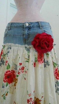 I think I'd sew floral fabric under denim so denim would fray and bring floral fabric up on sides further to accent curve of hips and avoid straight line at join.  Maybe with layers of tulle?  Neat use of old jeans.
