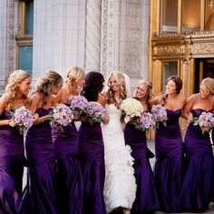 purple wedding - love the photo and the flowers! and the contrast of dresses!!!!