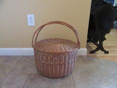 Very nice woven round basket with hinged lid and swing handles- nice condition…
