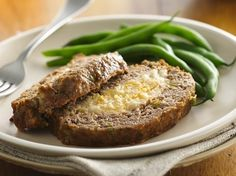 A meat-and-potato lovers' delight—tasty meat loaf stuffed with cheesy mashed potatoes! there are 2 great ways to have meatloaf.a different spin for a great meal ! Cheese Stuffed Meatloaf, Stuffed Meatloaf Recipes, Great Recipes, Favorite Recipes, Dinner Recipes, Weeknight Recipes, Delicious Recipes, Meatloaf Ingredients, Cheesy Mashed Potatoes