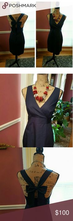 *NEW LISTING* BACK ATTACK SUNDRESS This gorgeous sundress makes a statement coming and going. The plunging neckline and girly bow in the back make it a must have for your wardrobe. The color is navy, the material is cotton taffeta. J. Crew Dresses Backless