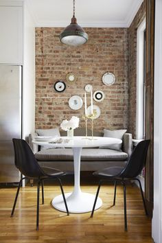 Kitchen breakfast nook, exposed brick wall, artwork, wood flooring