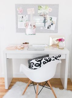 A statement making striped wall, perfectly styled bookshelf, and champagne had us falling for this home office tour at first glance.
