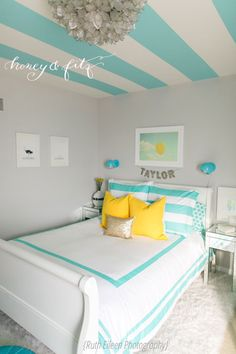 This striped ceiling makes such an impact in this turquoise tween room! #kidsroom