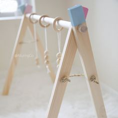 This adorable wooden baby gym is the perfect place for your baby to hang out and enjoy the day. Its clean crisp modern day look allows it to fit