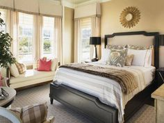 http://www.ultimatechristoph.com/wp-content/uploads/2014/05/neutral-bedroom-colors-with-bench-and-small-mirror-and-black-bed-frame-and-tan-curtains-with-valances.jpg