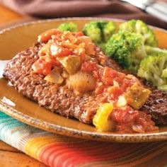 """Creole Steaks Recipe -Here's a way to """"fancy up"""" an economical cut of beef. I created the recipe as a variation on Swiss steak. Serve this entree with rice to catch the flavorful sauce. —Nicole Filizetti, Jacksonville, Florida"""