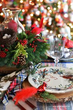 Christmas table by the tree with tartan plaid and hurricane centerpiece with evergreens and Cardinals | homeiswheretheboatis.net #Christmas #tablescape #LynchCreekFarm #tartan