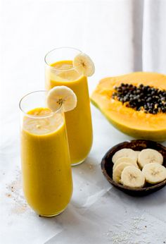 A paleo and vegan friendly smoothie packed with the mega nutrients from turmeric tea golden milk and tropical fruit combined! Packed with fiber healthy fats and a whole lotta nourishment! Fruit Smoothies, Smoothies Vegan, Smoothie Drinks, Smoothie Diet, Smoothie Recipes, Papaya Smoothie, Juice Recipes, Party Recipes, Vegetable Smoothies