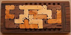 Pentominoes styled like animals in wood, in 5x12 rectangular tray