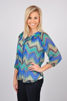 You'll be the center of attention in our Chevy Me Crazy Top! This top features a chevy print with different designs throughout. Pair with those favorite pair of jeans or leggings, your boots, and you're all set to hit the town! This top is made out of 100% Polyester. Hand-wash cold, hang or line dry.