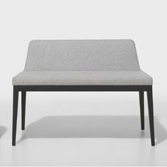 The ARROP Bench for Jane Hamley Wells has a narrow upholstered frame & wooden legs, adding a touch of lightness to a living room, office & any room in between.