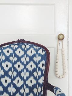 Blue and White Madeline Weinrib fabric on a vintage chair, image via Caitlin Flemming Design
