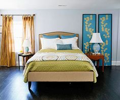 Light blue walls with bright green and blue. Master bedroom