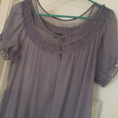 Express Short Sleeve Express Short Sleeve. Size M. Gathered at the bottom. 100% polyester. Awesome shape. Express Tops Blouses