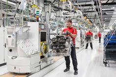 Technicians assembling engine at Porsche v-8 factory