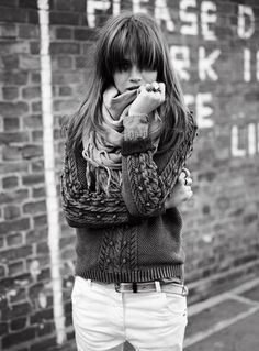 Chunky knit pullover. Big scarf. Messy hair.