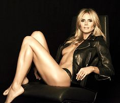 Heidi Klum poses in a leather jacket and panties for Sharper Image's