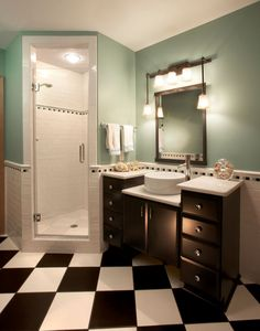 Black and white checkered tile, seafoam green walls, bathroom remodel part of a whole house remodel by B&E General Contractors in Glendale, WI