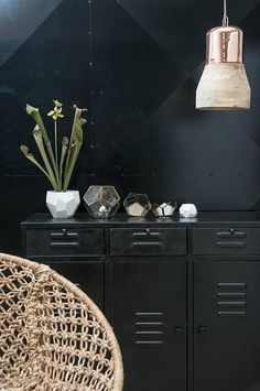 love black lockers on a black wall with copper lighting and natural fibers for brightness