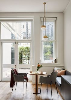 built in seating Built In Furniture, Space Saving Furniture, Melbourne Apartment, Open Plan Apartment, Built In Cupboards, Banquette Seating, Tiny Apartments, Drop Leaf Table, Timber Flooring