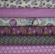 I owe my friend a blanket, and she LOVES purple. This fabric combination would be perfect!