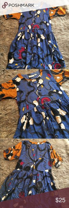 """Vintage loose fit dress abstract print Vintage dress. Abstract print. Gold/blue/red colors. Low waist. Length: 37"""", bust: 19"""", sleeves : 11"""". Good condition. Dresses"""