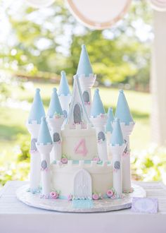 Gorgeous castle cake at a Cinderella birthday party! See more party planning ideas at CatchMyParty.com!