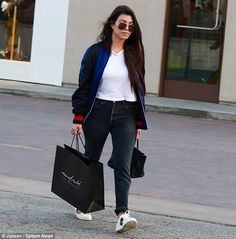 Playing Santa? Kourtney Kardashian looked to be getting in some Christmas shopping on Mond...