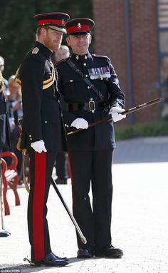 Prince Harry talks to the Regimental Sergeant Major during his visit to The Duke of York's Royal Military School in Dover where he surprised students