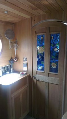 Stained glass bathroom door by Beacon Boats LTD