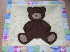 applique baby quilt with lambs, teddy bear and sun