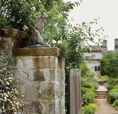 A bronze rabbit by sculptor Jane Canfield perches atop the garden gate. Bunny Mellon's Oak Spring estate, in Upperville, Virginia