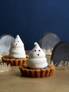 Boo! Knock guests' socks off with meringue-topped chocolate ganache tartlet—the perfect sweet and spooky Halloween dessert.