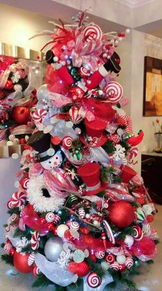 Choose the Best Christmas Tree decorating ideas. These Christmas Tree decorations are the best & trending Christmas decorations ideas of the year. Candy Cane Christmas Tree, Beautiful Christmas Trees, Colorful Christmas Tree, Christmas Tree Themes, Holiday Tree, Xmas Tree, Christmas Tree Decorations, Christmas Wreaths, Christmas Villages