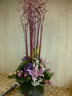 twig arrangement with ornamental cabbages