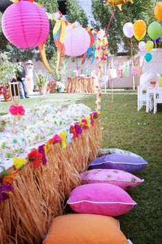 Beach party idea. Dress your table in a grass skirt and have the kids sit on pillows.