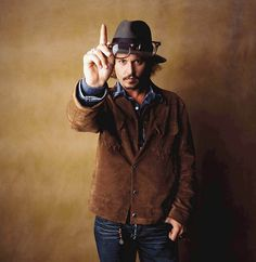 Johnny Depp - worn leather jacket and a fedora