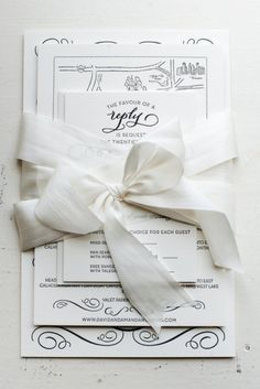 Invitation suit wrapped in ribbon