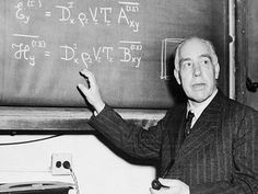 In 1913, Danish scientist Neils Bohr (1885-1962) developed a quantum theoretical model of the hydrogen atom in which the electrons orbit the nucleus. His model predicted the frequencies of spectral lines that other physicists had only observed, and he received the 1922 Nobel Prize for Physics for his work. Bohr also helped develop the atomic bomb. In this photo, he discusses an equation at Princeton University, N.J., on March 21, 1950.