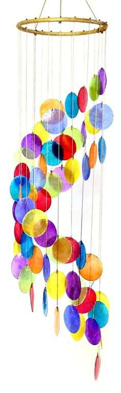 "- Beautiful spiral rainbow colored capiz wind chime - Bamboo top - 31.5 "" Long Capiz is the outer shell of a Windowpane Oyster; a thin translucent shell which makes a beautiful full sound"