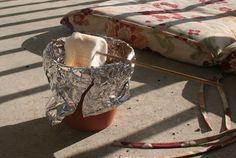 Make s'mores using a flower pot