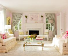 The blush walls, soft mint, and creams throughout make for a stunningly feminine space. I love the symmetry and the sofa fringe, plus the splashes of fuchsia.