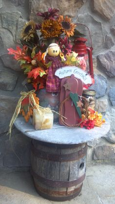 small porch table decorated for fall