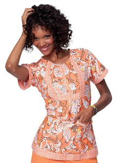 A beautiful pair of prints in sunset orange make this scrub top a fashion choice.  #orangeisthenewblack
