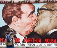 Russian artist Dmitri Vrubel's Berlin Wall mural Fraternal Kiss depicts former East German leader Erich Honecker embracing former Soviet premier Leonid Brezhnev at a 1979 meeting. Robert Doisneau, Berlin Ick Liebe Dir, Graffiti, Berlin Street, Berghain, East Side Gallery, Berlin Travel, Berlin Wall, Berlin Germany