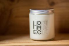 tobacco & vanilla 100 soy wax candle with a wooden by HOMECGOODS