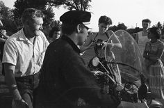 Elvis and his Dad  Vernon Chat with Fans - 	Elvis on his Harley with his dad Vernon lookingon, chat with young well-wishers on the frontlawn of their home at 1034 Audubon Drive,Memphis, TN. July 4, 1956.